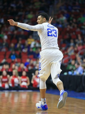 Kentucky's Jamal Murray fires off an arrow after hitting a three-point shot as part of his 19 points in the Wildcats' easy 85-57 win over Stony Brook Thursday night in Des Moines. Murray also had seven rebounds and two blocks.