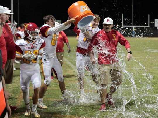 Palm Desert is DVL champs and Aztec head coach Shane McComb gets wet on Friday, November 3 2017 in Indio.