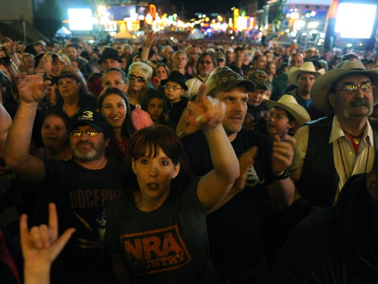 Fans watch Colt Ford's performance at the NRA Country