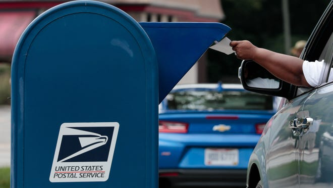 A man mails a letter on Saturday, August 22, 2020 in Whitehall.