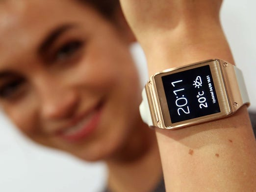 A woman wears the new Samsung Galaxy Gear smartwatch at the Samsung Unpacked 2013 Episode 2 event at the IFA consumer electronics trade show on Sept. 4, 2013, in Berlin.