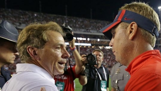 Alabama coach Nick Saban and Mississippi coach Hugh Freeze talk after Saturday's 43-37 win for Ole Miss over the Crimson Tide.