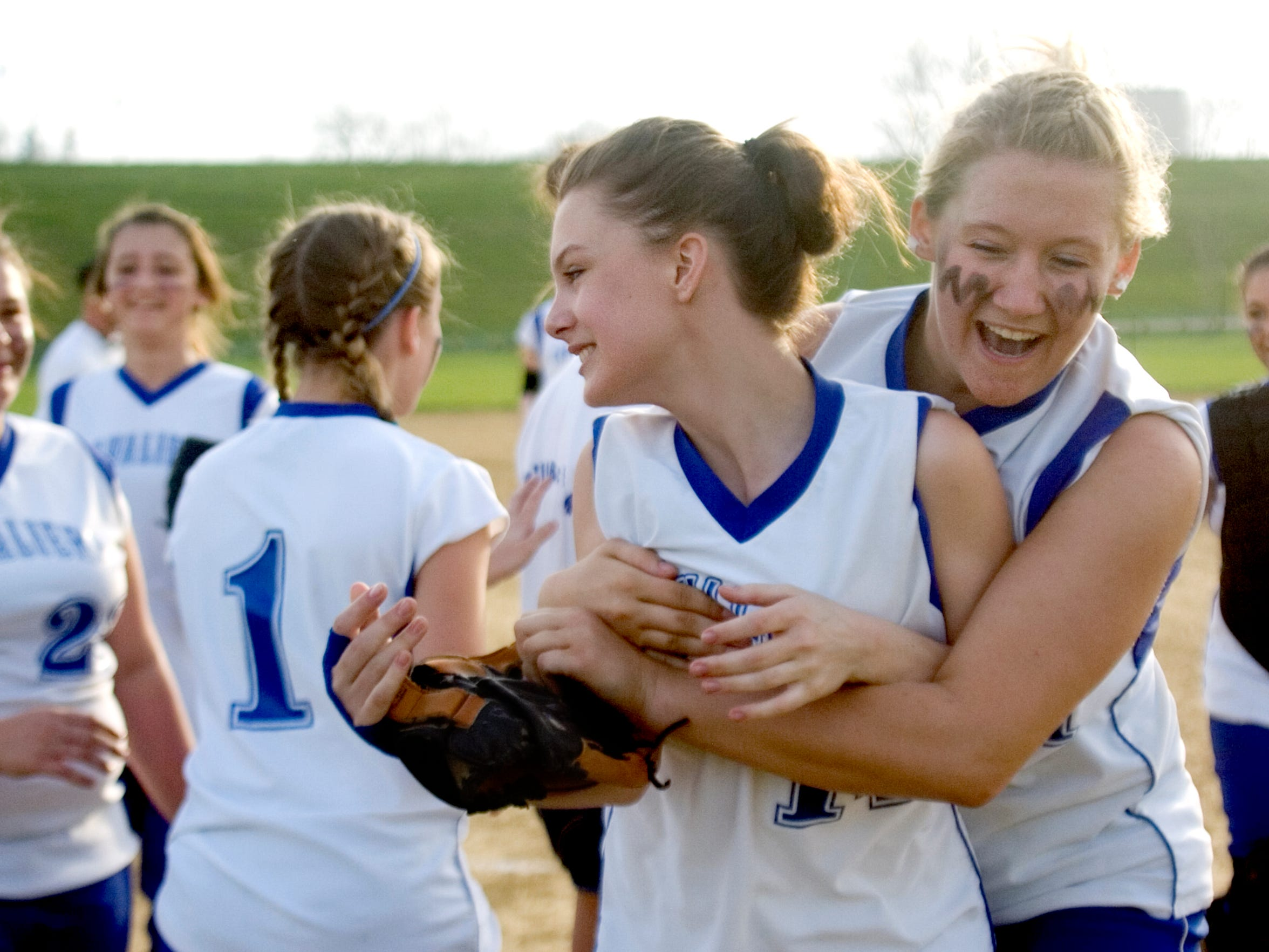 Chillicothe's Sasha Johnson is hugged by Holly Casto-Lemay, right, after the Cavaliers won their first game in three years; against Paint Valley.