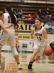 Dayton's Shawnie Spink dribbles to her left against Rainier on Friday, March 2, 2018.
