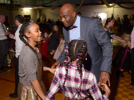Windle Riles dances with daughters Mayson, 11, and Madyson, 10, at the Father Daughter Dance at the Franklin Recreation Complex on Saturday.
