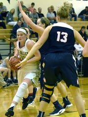 Alyssa Edwards-Frick drives to the basket during Tri-Valley's 42-29 win against Morgan on Saturday in Dresden.