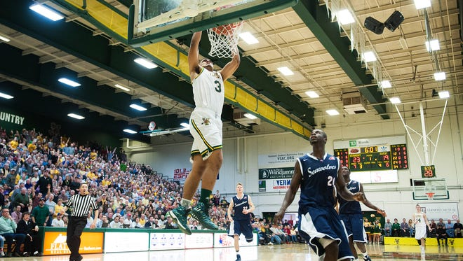 Vermont freshman Anthony Lamb goes up for a dunk on a fastbreak during the first half of Saturday's college men's basketball game at Patrick Gym.