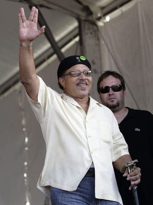 Art Neville waves to the crowd as he arrives to perform during the 2008 New Orleans Jazz & Heritage Festival at the New Orleans Fairgrounds Racetrack in New Orleans. He will performing with The Funky Meters at the 27th annual Crawfish Festival, which takes place June 3 to 5.