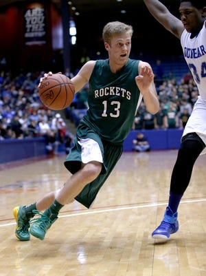 McNicholas forward Andrew Schuermann drives to the basket against Dunbar, Friday, March 13, 2015, at University of Dayton Arena. McNicholas lost 69-57.