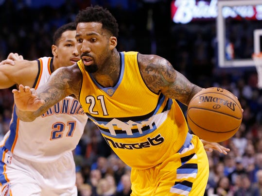 Denver Nuggets forward Wilson Chandler (21) drives around Oklahoma City Thunder forward Andre Roberson (21) in the second quarter of an NBA basketball game in Oklahoma City, Saturday, Jan. 7, 2017. (AP Photo/Sue Ogrocki)