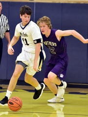 Greencastle's Ben Freeman (11) races the ball up the