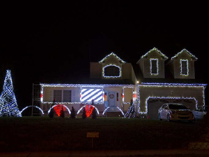 The Cook's Christmas Light Show at 1 Carlson Ct. in