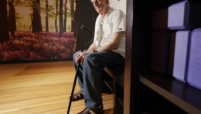 Massage therapist Norbert Rosenow, 82, sits in one of the workout classrooms at the Greater Green Bay Downtown YMCA. Rosenow, who is blind, has worked as a massage therapist at the downtown YMCA for 50 years and still gives massages there three days a week.