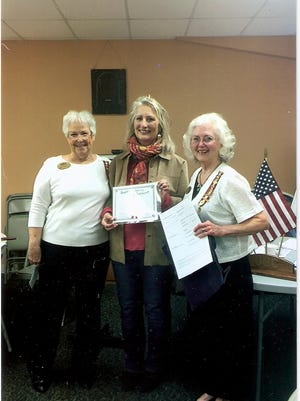 Caroline Meriwether Goodlett Chapter of the United Daughters of the Confederacy recently welcomed Brenda Mackey into their chapter. Janice Hamann, left, president and Dianne Freeman, right, registrar,  presented Mackey with her certificate of membership. This means she has ancestors who fought for the Confederacy during the Civil War.