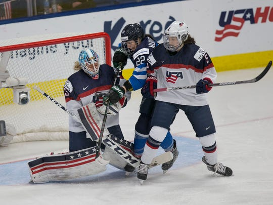 U.S. goalie Alex Rigsby wards off a Finland shot Monday with support from blueliner Megan Keller (5).