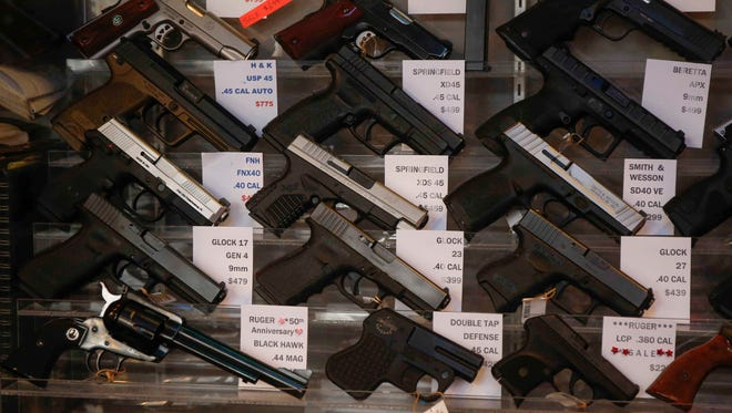Hand guns on display at The Pawn Shop on Friday, Jan. 26, 2018, in Des Moines.