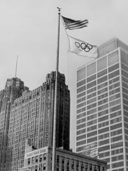 Olympic flag flies in downtown Detroit as the city was making bid for 1968 Olympics on March 7, 1963.