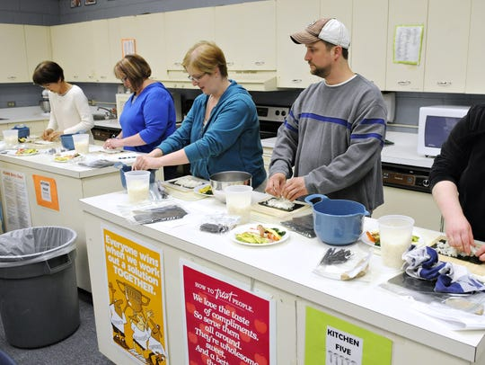 Misa Feldhege, left, leads a sushi-making class at