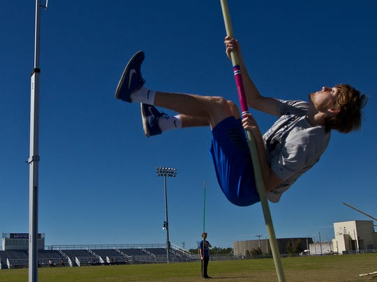 Jordan Diggs, of Ida Baker HS in Cape Coral, works on his pole vaulting technique during a track and field team practice Wednesday afternoon (2/17/16).