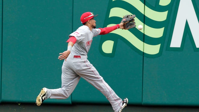 Cincinnati Reds center fielder Billy Hamilton (6) can't get to an RBI double hit by St. Louis Cardinals' Yadier Molina in the fourth inning of a baseball game, Saturday, April 18, 2015, in St. Louis.