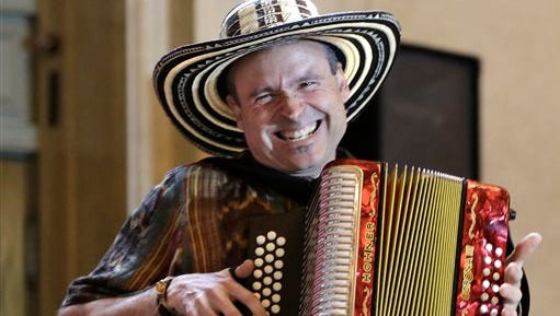 "Phil ""Felipe"" Passantino, leader of the Viva Vallenato Accordion Band, auditions for judges in Grand Central Terminal's Vanderbilt Hall in New York, Tuesday, May 19, 2015. Passantino was among a group of about 70 potential subway performers seeking official permission to set up their acts on an underground platform or walkway to entertain New York city's commuters.  (AP Photo/Kathy Willens)"