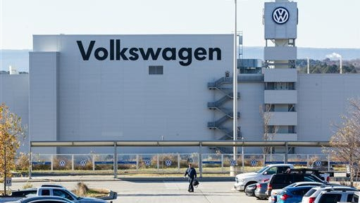 A man walks through the employee parking lot at the Volkswagen plant in Chattanooga, Tenn., on Friday, Dec. 4, 2015.