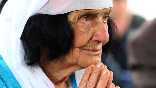 An Albanian woman prays during the mass at the cathedral in the northern city of Shkoder, Albania, celebrating the beatification of 38 Catholic martyrs executed or tortured to death during the former communist regime Saturday, Nov. 5, 2016. Albanians celebrated their beatification after Pope Francis had officially recognized as martyrs Archbishop Vincens Prenushi and 37 other priests who died in prison or were murdered in 1945-1974 by the late communist dictator Enver Hoxha's regime.
