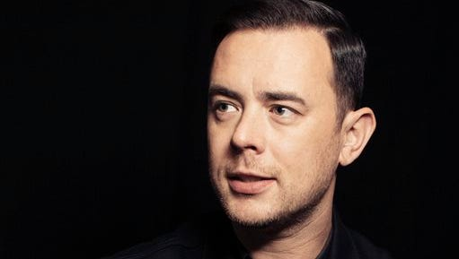 "In this Oct. 26, 2016 photo, Colin Hanks poses for a portrait in New York to promote his series, ""Life in Pieces."" Hanks will direct an upcoming documentary on the American band, Eagles of Death Metal, before and after the 2015 Paris terror attack at one of their concerts that killed 89 people."