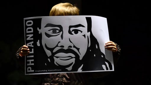 Judah O'Hara, 4, a student at J.J. Hill Montessori school shows a sign in support of Philando Castile at a rally in St. Paul, Minn., Wednesday, Nov. 16, 2016. Jeronimo Yanez, a Minnesota police officer who shot Castile, was charged Wednesday with second-degree manslaughter following an investigation by prosecutors, who concluded that Yanez was wrong to use his weapon in the traffic stop, which was seen by millions after Castile's girlfriend streamed his final gruesome moments live on Facebook.