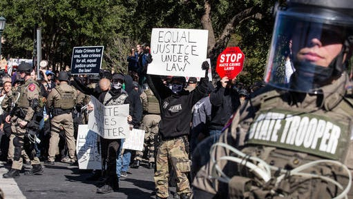 Police in riot gear hold counter-protestors away from a White Lives Matter rally in front of the Texas State Capitol in Austin, Texas, on Saturday, Nov. 19, 2016. Earlier in the day, officials unveiled a monument recognizing the contributions of African-Americans to the state.