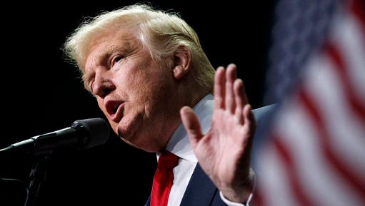 FILE - In this Nov. 4, 2016, file photo, Donald Trump speaks in Hershey, Pa. President-elect Trump holds stock in the company building the disputed Dakota Access oil pipeline, and pipeline opponents warn that Trump's investments could undercut any decision he makes on the $3.8 billion project as president.