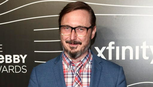 """FILE - This May 16, 2016 file photo shows John Hodgman at the 20th Annual Webby Awards in New York. The author, actor and comedian has a deal with Viking for a book called """"Vacationland,"""" in which he writes of his physical journey to the coast of Maine and his spiritual journey of living through middle age. The book will be released in the fall."""