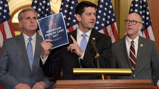 House Speaker Paul Ryan of Wis. (center), standing with Energy and Commerce Committee Chairman Greg Walden, R-Ore. (right), and House Majority Whip Kevin McCarthy, R-Calif. (left), speaks during a news conference on the American Health Care Act on Capitol Hill in Washington, Tuesday, March 7, 2017.