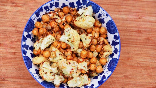 This March 6, 2017 photo shows a cauliflower, chickpea and onion side dish in Coronado, Calif. This dish is from a recipe by Melissa d'Arabian.