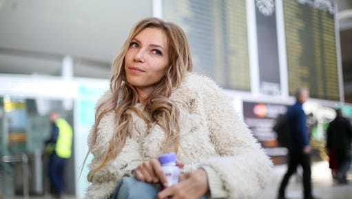 In this photo taken on Tuesday, March 14, 2017, Russian singer Yulia Samoylova who was chosen to represent Russia in the May 11-13 Eurovision Song Contest being held in the Ukrainian capital Kiev, poses while sitting in a wheelchair at Sheremetyevo airport outside Moscow, Russia. Ukraine's security service has banned Russia's 27-year old contestant Samoylova who has been wheelchair-bound since childhood, from this year's Eurovision song contest.