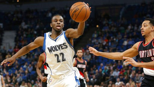 Minnesota Timberwolves forward Andrew Wiggins (22) controls the ball over Portland Trail Blazers guard CJ McCollum (3) in the second half of an NBA basketball game, Monday, April 3, in Minneapolis. The Timberwolves won 110-109.