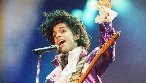"FILE - In this Feb. 18, 1985 file photo, Prince performs at the Forum in Inglewood, Calif. A year after Prince died of an accidental drug overdose, his Paisley Park studio complex and home is now a museum and concert venue. Fans can now stream most of his classic albums, and a remastered ""Purple Rain"" album is due out in June 2017 along with two albums of unreleased music and two concert films from his vault."