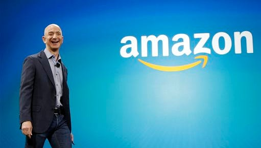 Amazon CEO Jeff Bezos walks on stage for the launch of the new Amazon Fire Phone, in Seattle. Amazon.com reports quarterly financial results on Thursday.