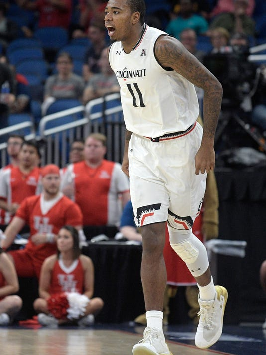 Cincinnati forward Gary Clark (11) celebrates after scoring a three-point basket during the first half of an NCAA college basketball championship game against Houston at the American Athletic Conference tournament Sunday, March 11, 2018, in Orlando, Fla. (AP Photo/Phelan M. Ebenhack)