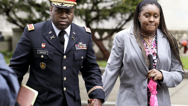 In this May 9, 2013, file photo, John Jackson, left, and his wife Carolyn Jackson, of Mount Holly, walk out of Martin Luther King, Jr. Courthouse, in Newark.