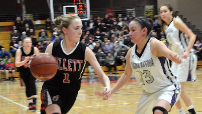 Sydney Young of Gillett dribbles around Tiara Barber of Oneida Nation in a Division 5 regional final at Oneida Nation High School on Monday, Feb. 26. No. 5 Gillett beat No. 1 seed Thunderhawks 66-65 in overtime. Gillett girls opened their season on Nov. 13.