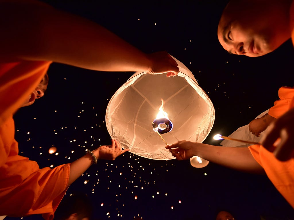 People from the Dai minority group prepare to launch a sky lantern as they celebrate their New Year on April 13 in Xishuangbanna, China.