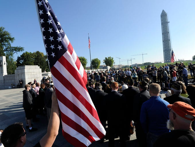 Veterans groups stage a demonstration against the partial government shutdown at the National World War II Memorial on Oct. 15 in Washington. A coalition of 33 veteran and uniformed services organizations say the shutdown threatens military benefits.