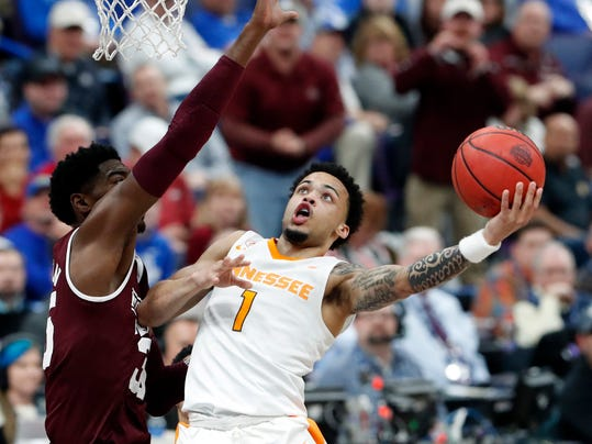 Tennessee's Lamonte Turner (1) heads to the basket as Mississippi State's Aric Holman defends during the second half of an NCAA college basketball game in the quarterfinals of the Southeastern Conference tournament, Friday, March 9, 2018, in St. Louis. Tennessee won 62-59. (AP Photo/Jeff Roberson)