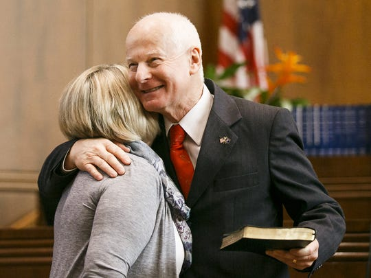 Dennis Richardson hugs his wife Cathy after being sworn in as secretary of state on Dec. 30, 2016.
