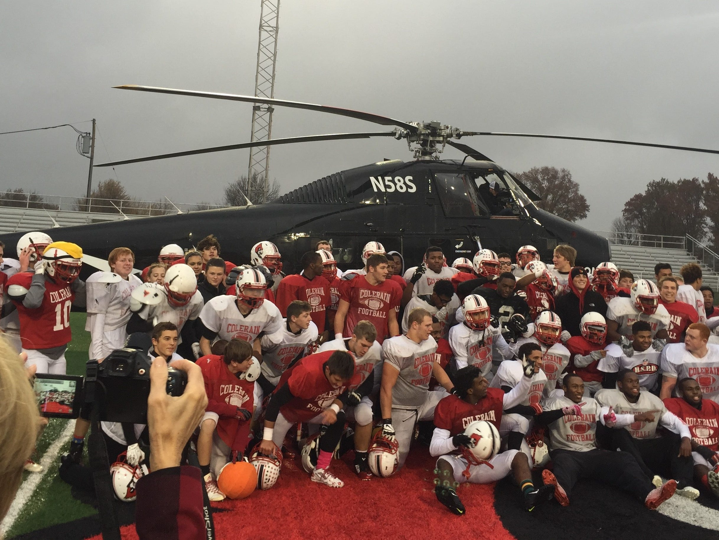 Colerain gathered in front of Nike's helicopter for a photo before seeing new cold weather football gear delivered by Nike Nov. 6, 2014.