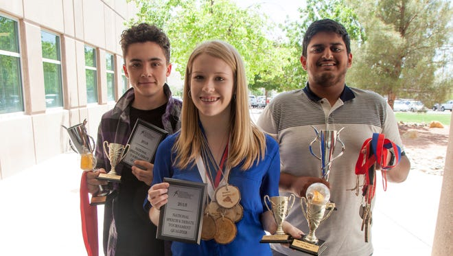 Brody Roberts, Alexa Naase and Yash Vyas lead the Dixie High School debate team Wednesday, April 25, 2018.