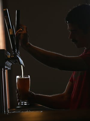 Swiftwater Brewing partner Patrick Meehan, working the taps.