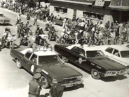 Picture of early motorcycle rally with Chris' Lounge in background.