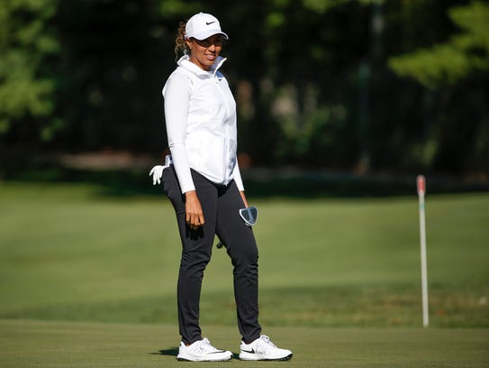 Cheyenne Woods finishes up a putt on hole four during